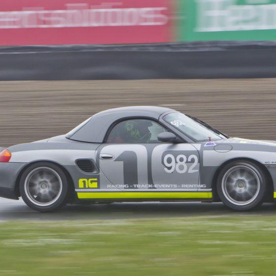 grey car racing circuit